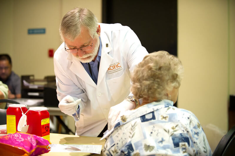 Doctor doing a health check on a female senior citizen