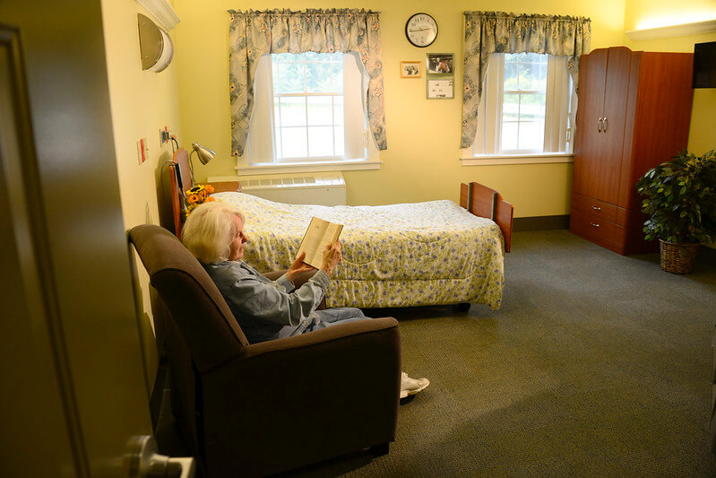 A veteran sitting while reading a book