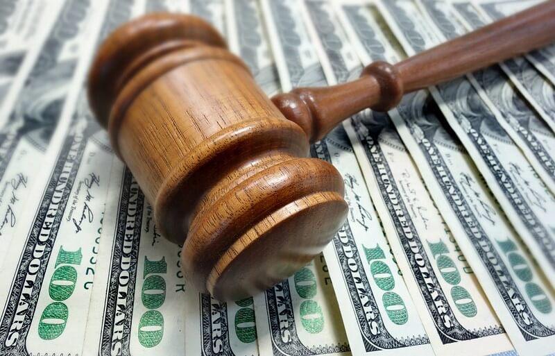 Court gavel on top of dollar bills