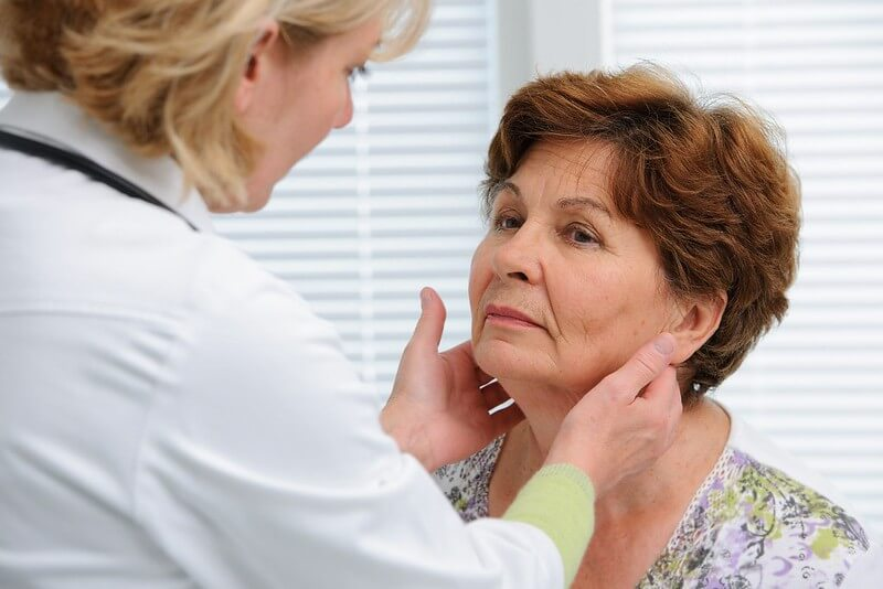 Doctor checking her patient for hypothyroidism