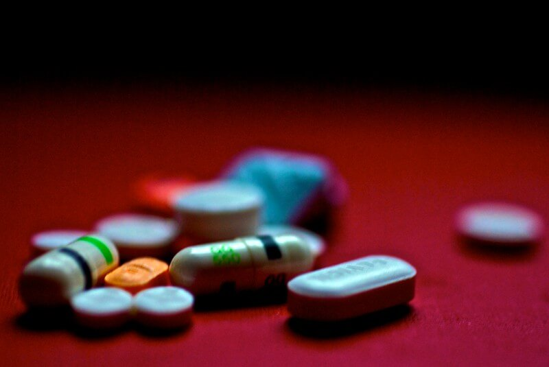 Medications scattered on the floor