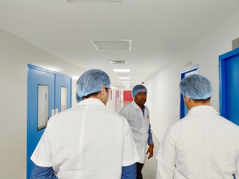 Pharmaceutical staff walking in a hallway