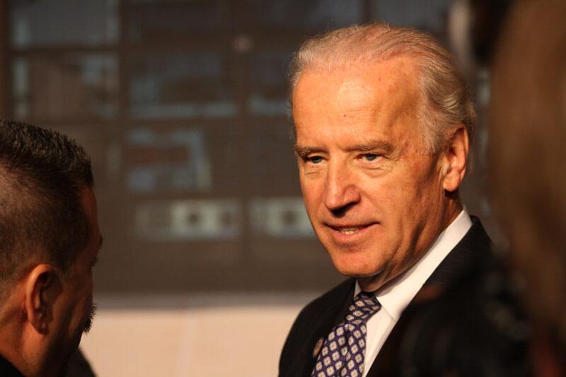 President-elect Joe Biden talking with someone