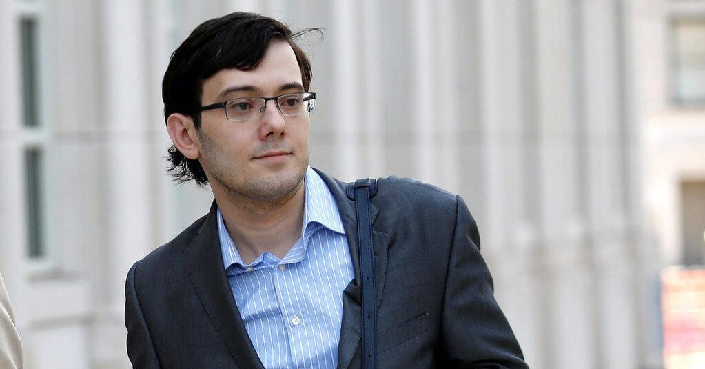 Martin Shkreli walking outside with glasses