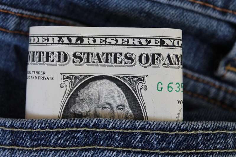Dollar bill inside jeans pocket