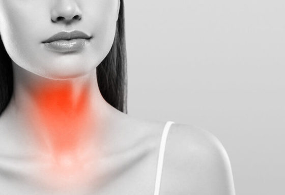Photo of a woman with her thyroid gland highlighted in red