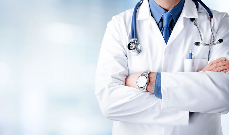 Half body shot of a doctor with stethoscope