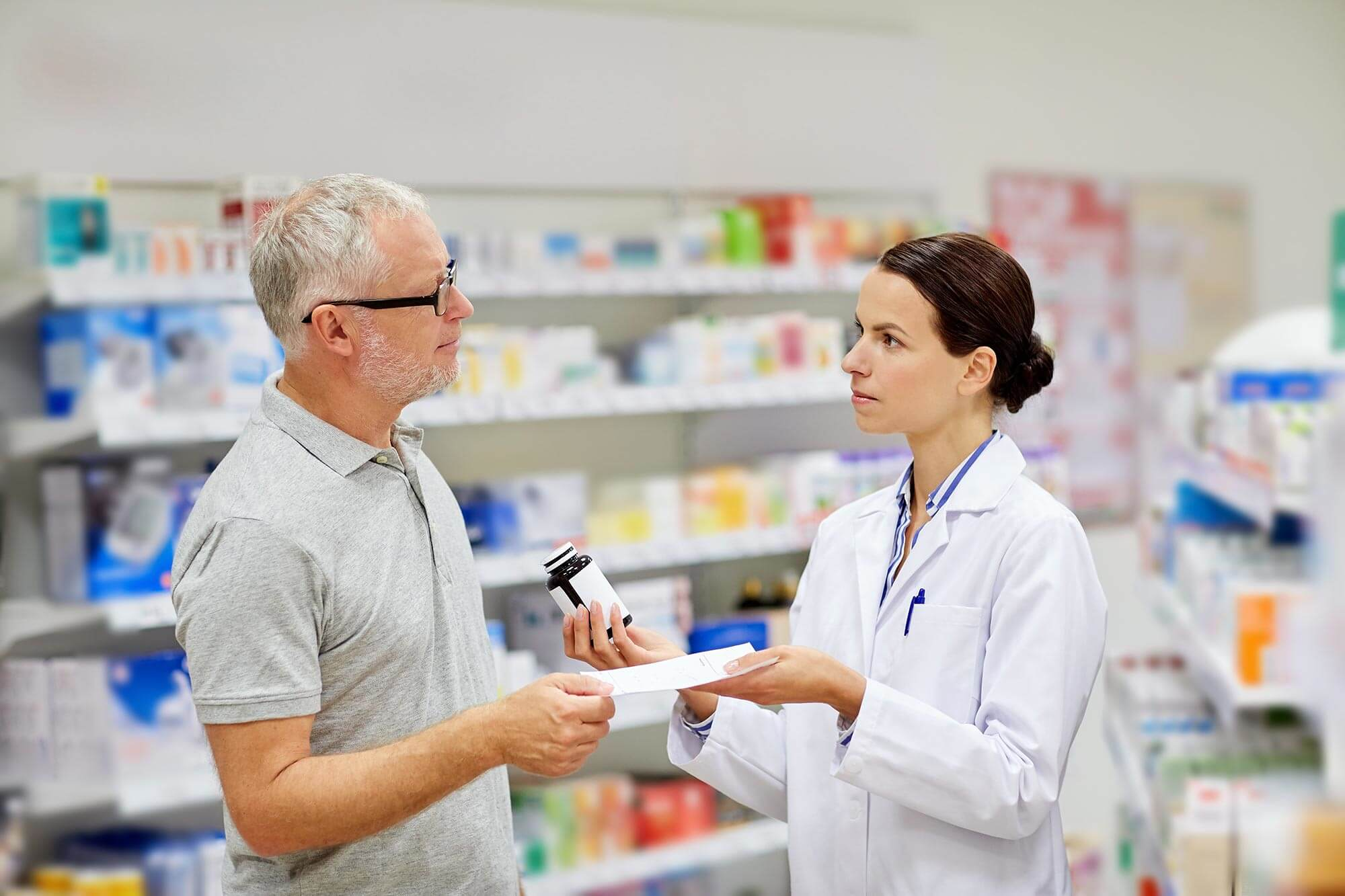 Senior citizen buying medications from a pharmacy