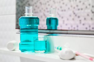 Mouthwash and toothbrush on the sink