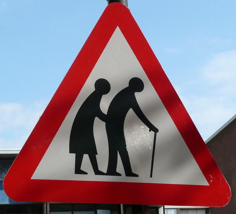 Traffic sign showing elderly people passing by