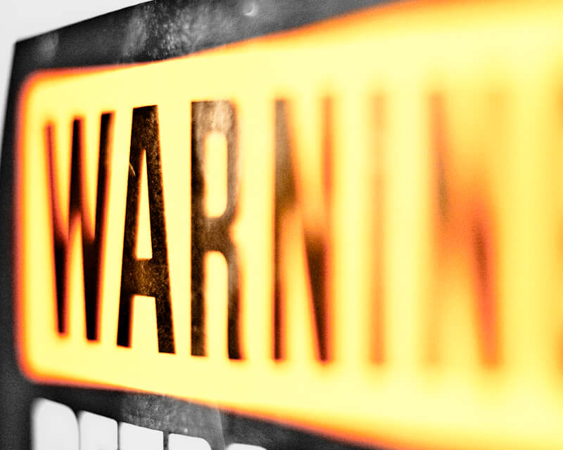 Photo of a sign with 'warning' written on it