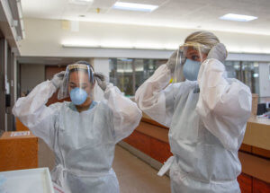 Nurses wearing PPE and face shields