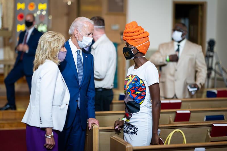Biden talking to a woman at the church