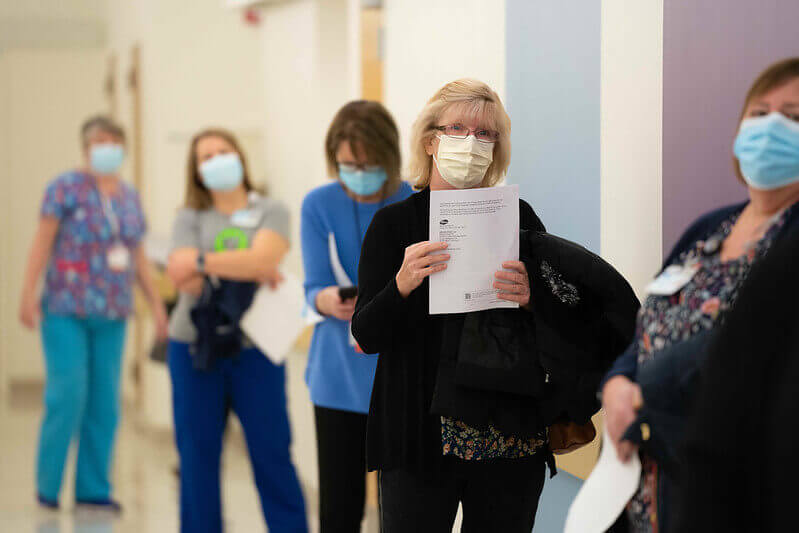 Hospital associates lining up for first COVID vaccination