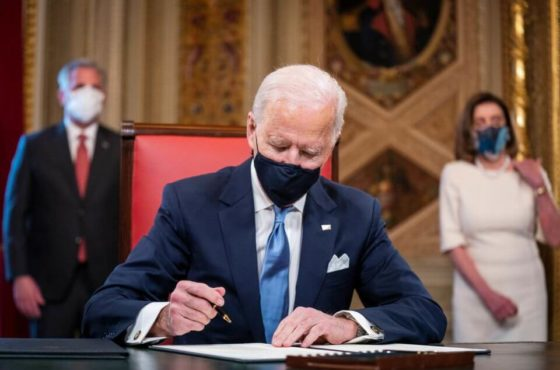 President Biden during inauguration signing papers