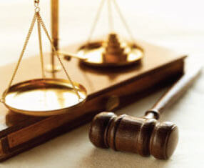 Photo of a gavel with the scales of justice