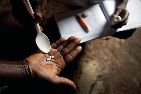 Photo of ivermectin tablets on a person's hand