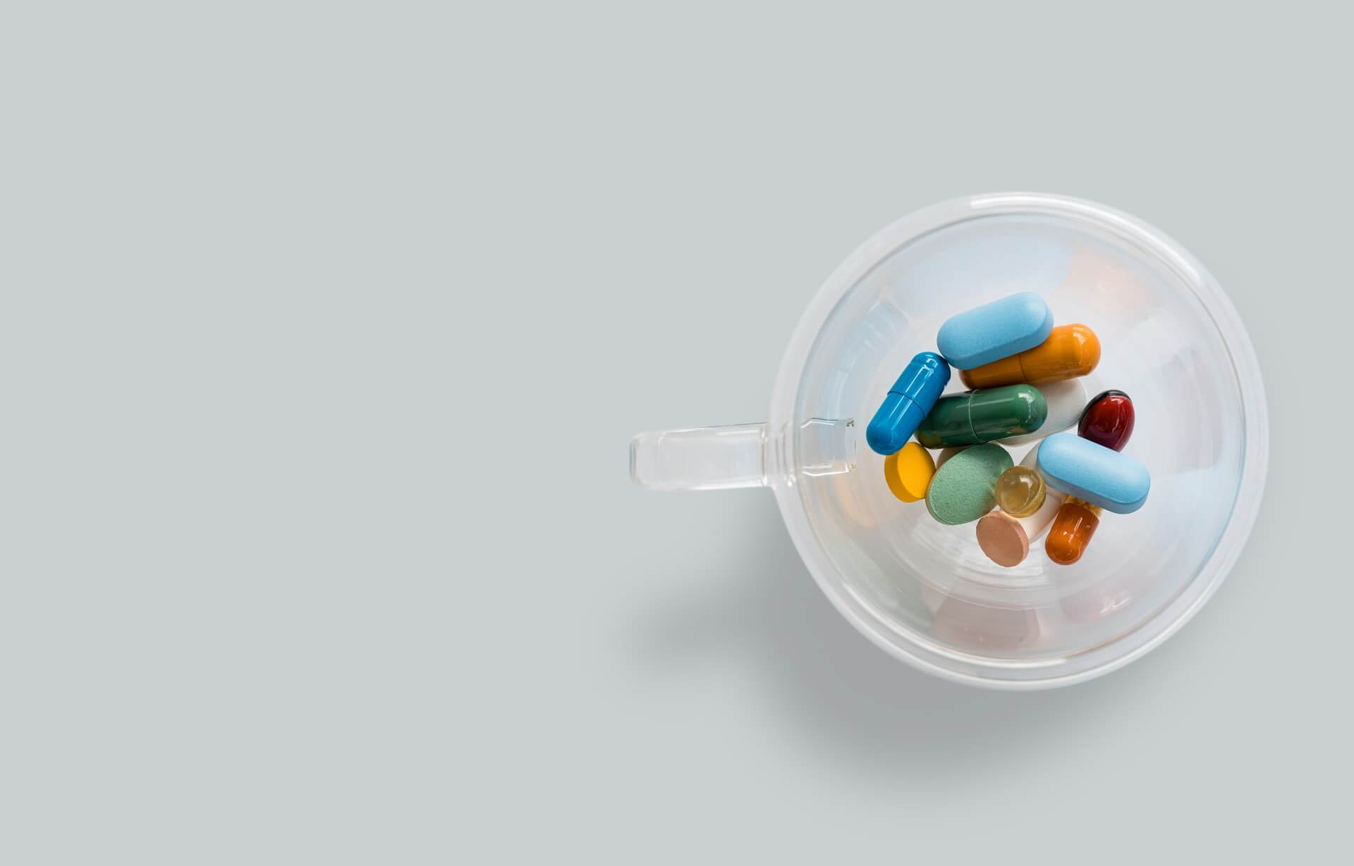 Colorful medicines in a cup