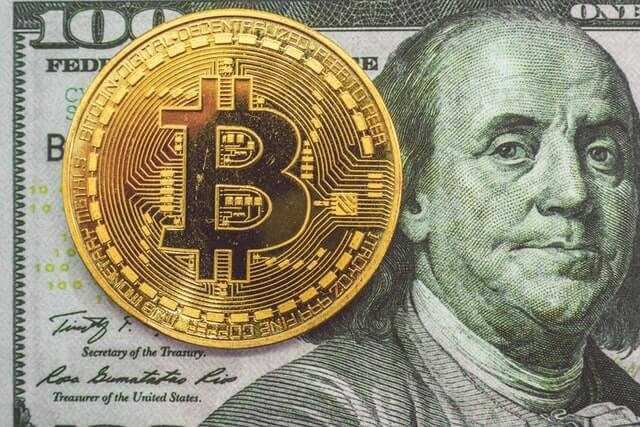 Dollar bill and a gold coin