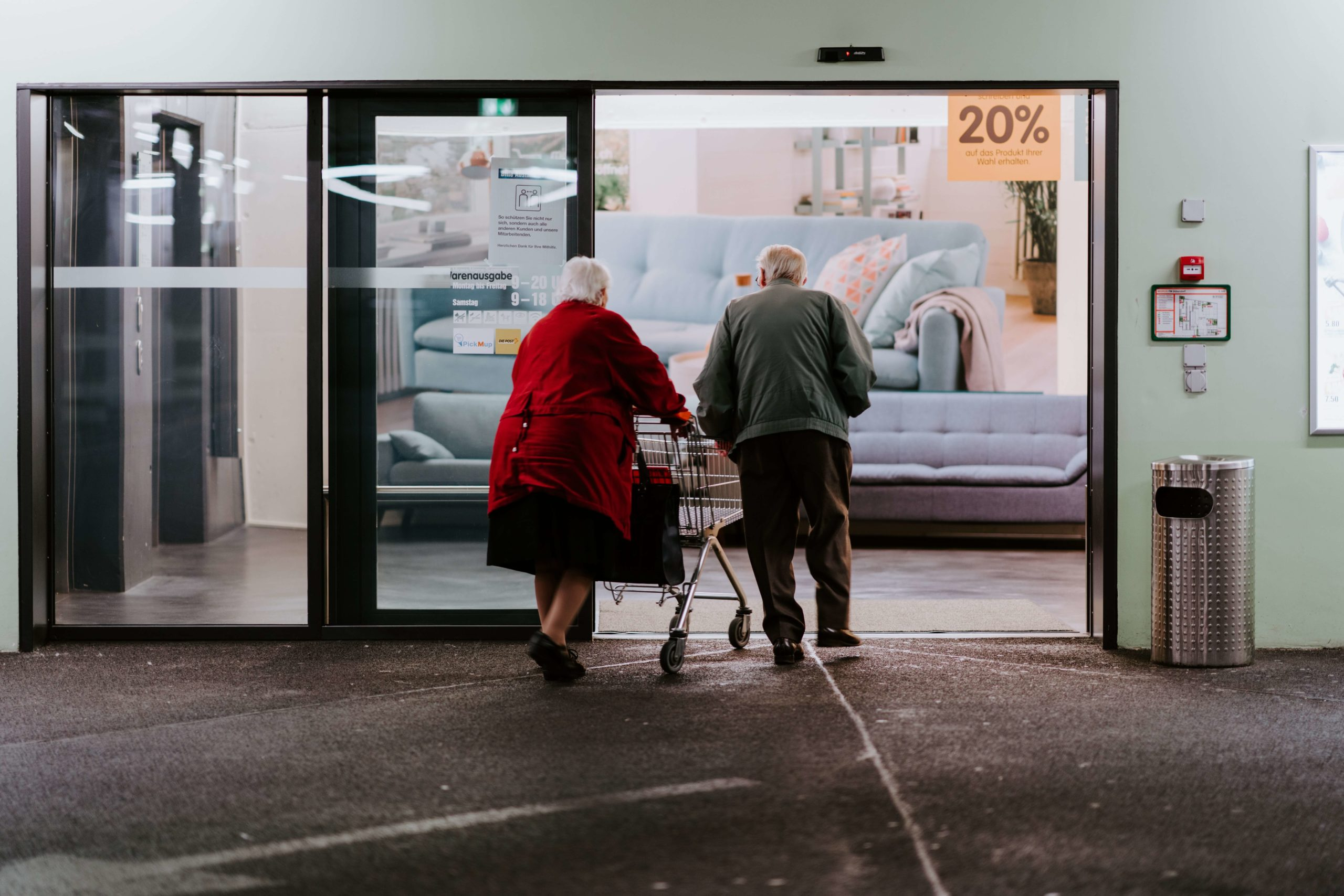 Seniors walking inside a store