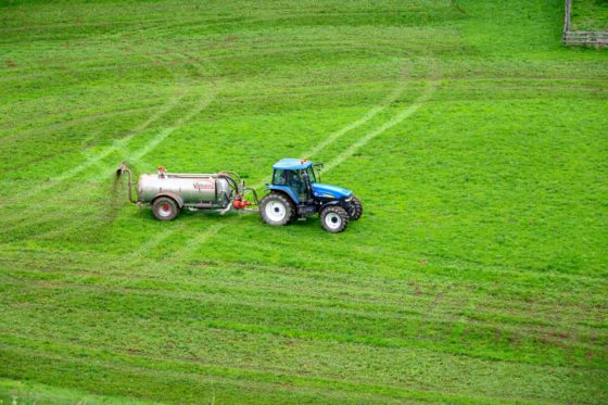 Truc spraying agricultural fertilizer on a field