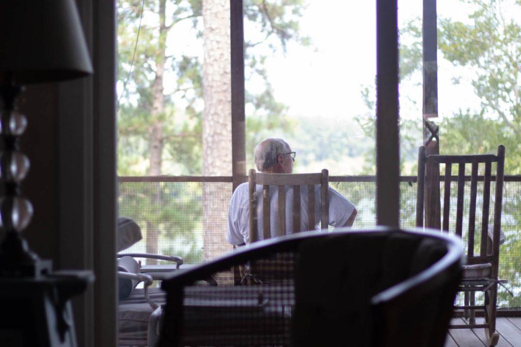 Grandpa sitting at the porch