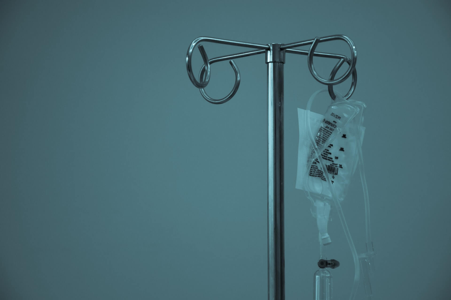Dextrose hanging on a stainless steel IV stand
