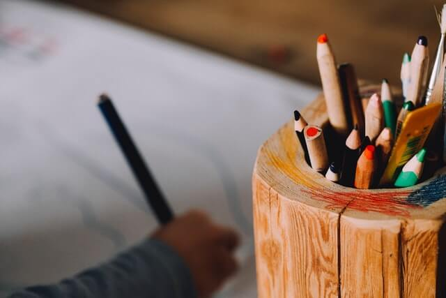 Close up of colored pencils used by a child