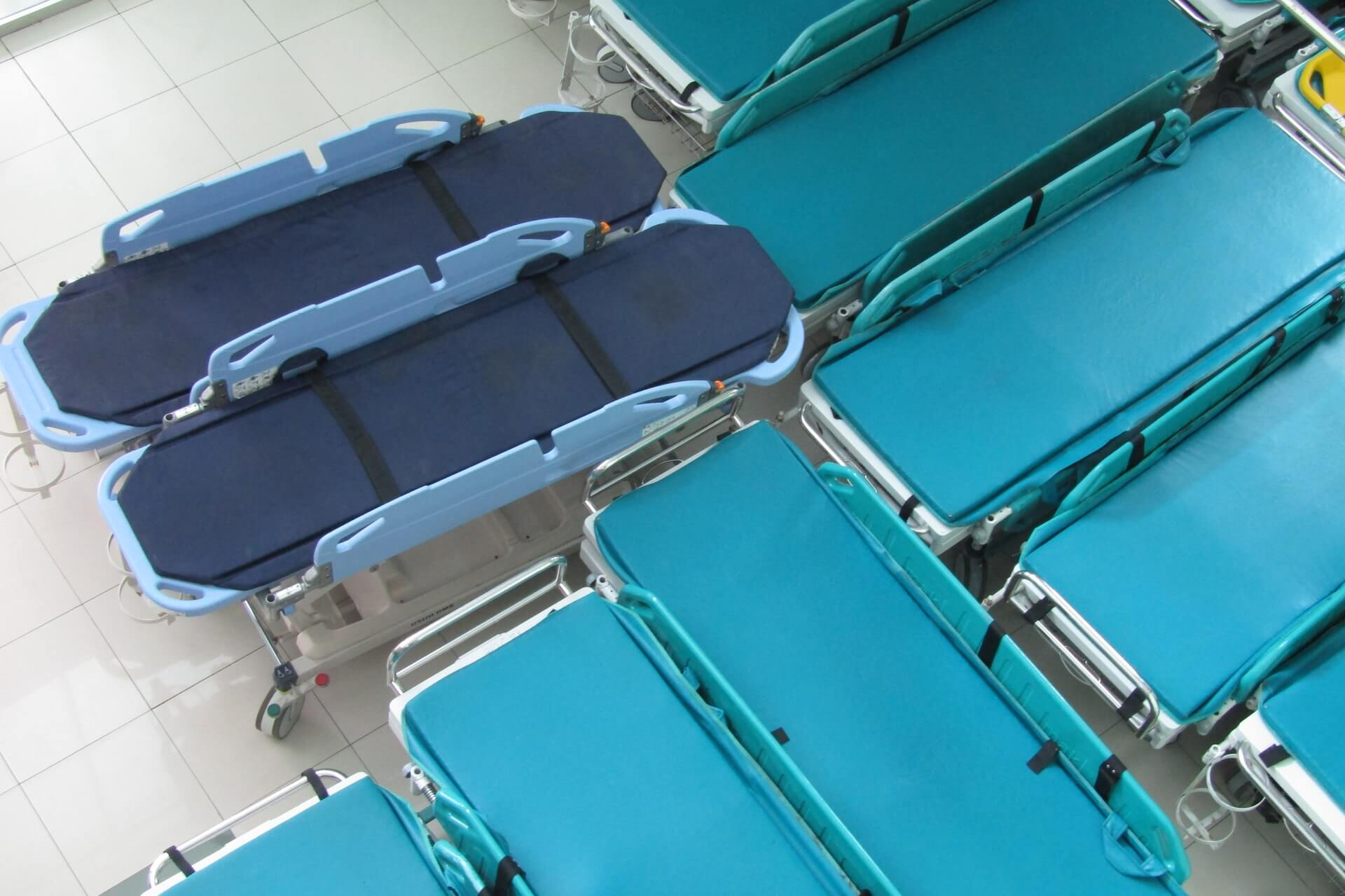 Empty hospital beds gathered in one place