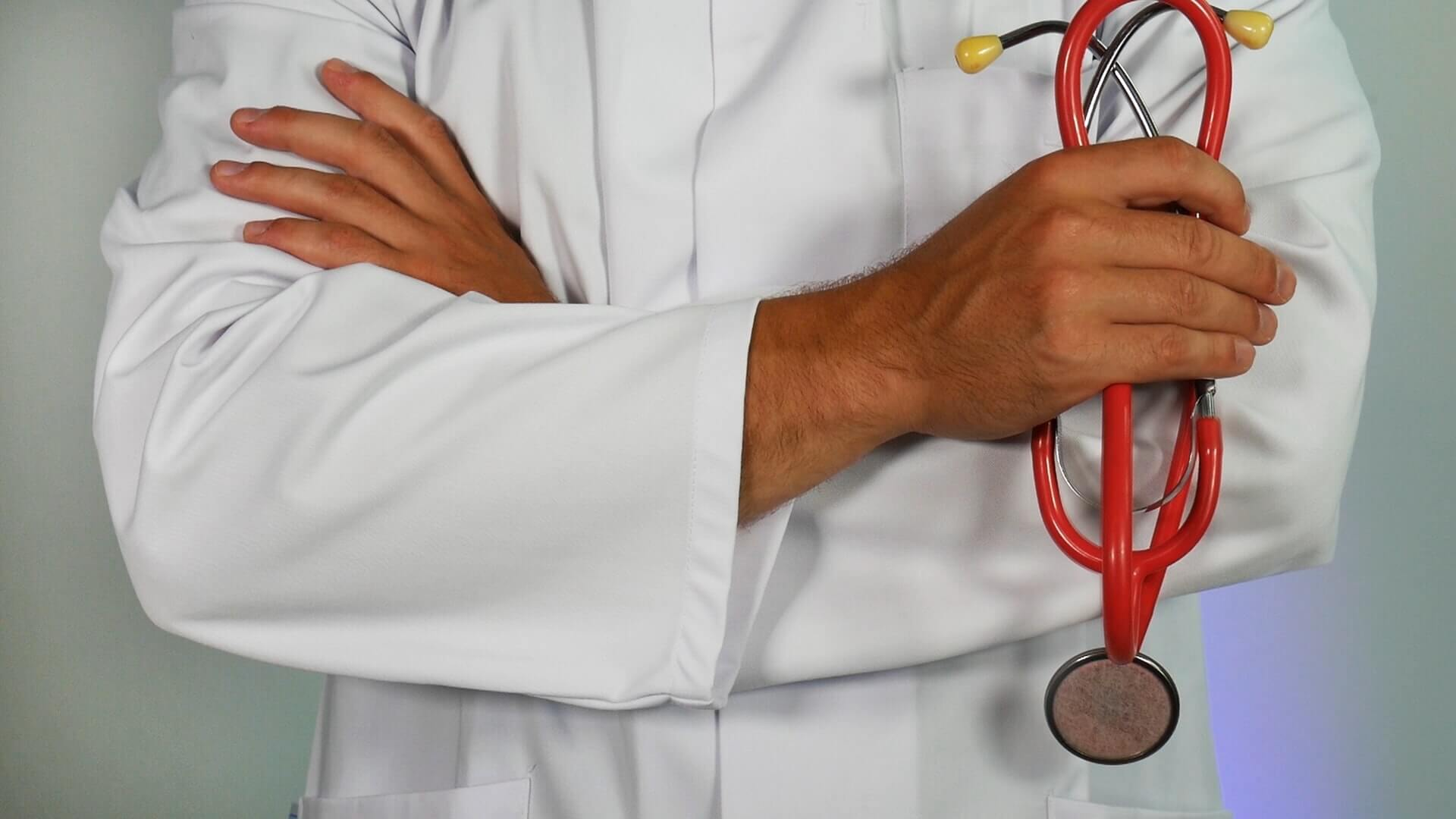 Doctor wearing lab gown with stethoscope