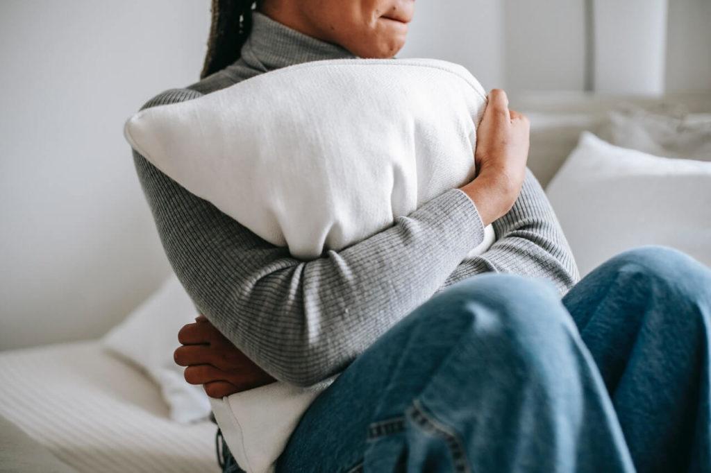 Woman hugging a pillow