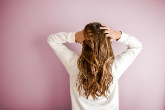 Woman touching the strands of her hair