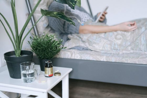Patient holding mobile phone while on bed rest