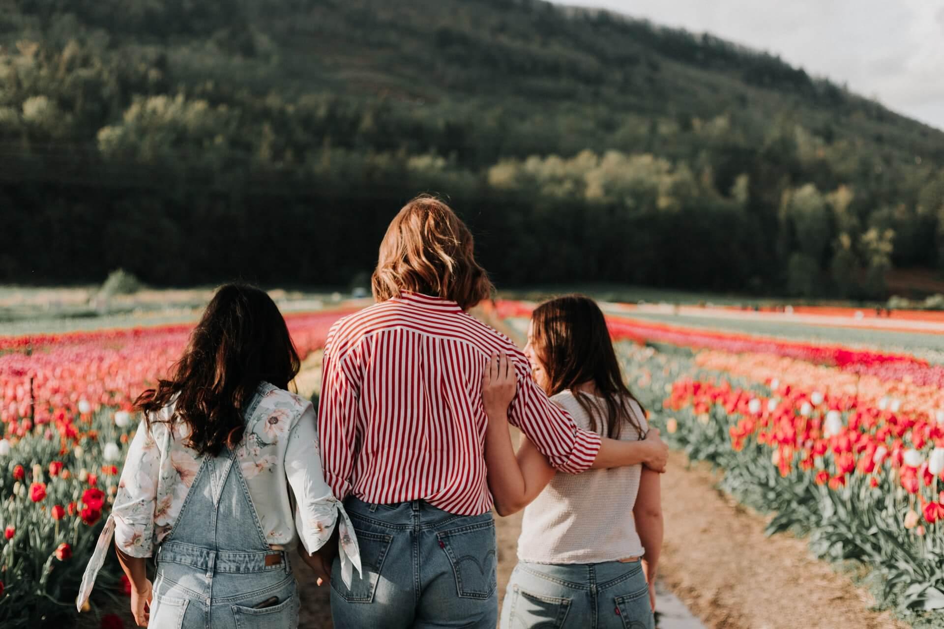 Three women walking on a field