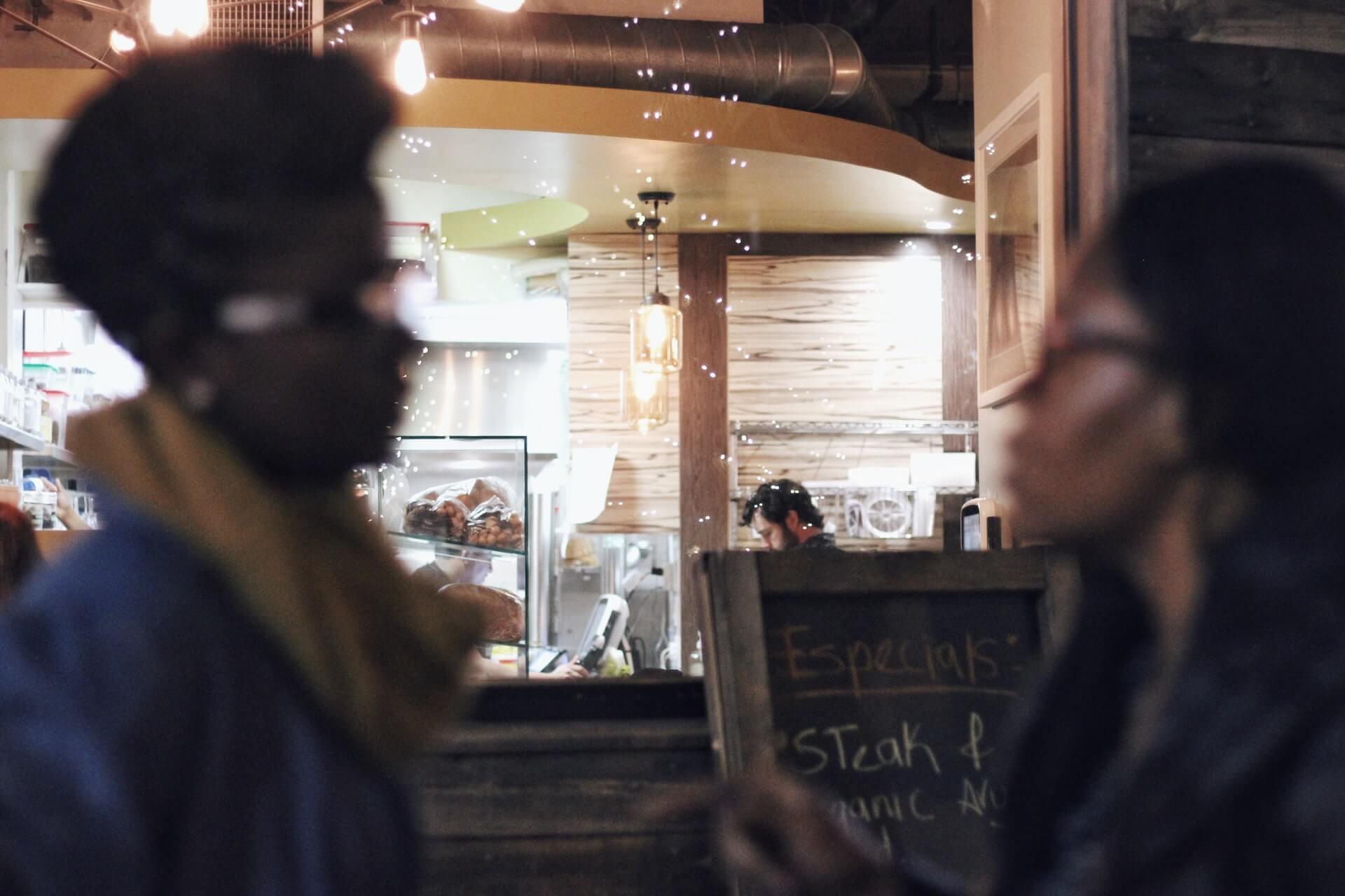 Women speaking outside a restaurant