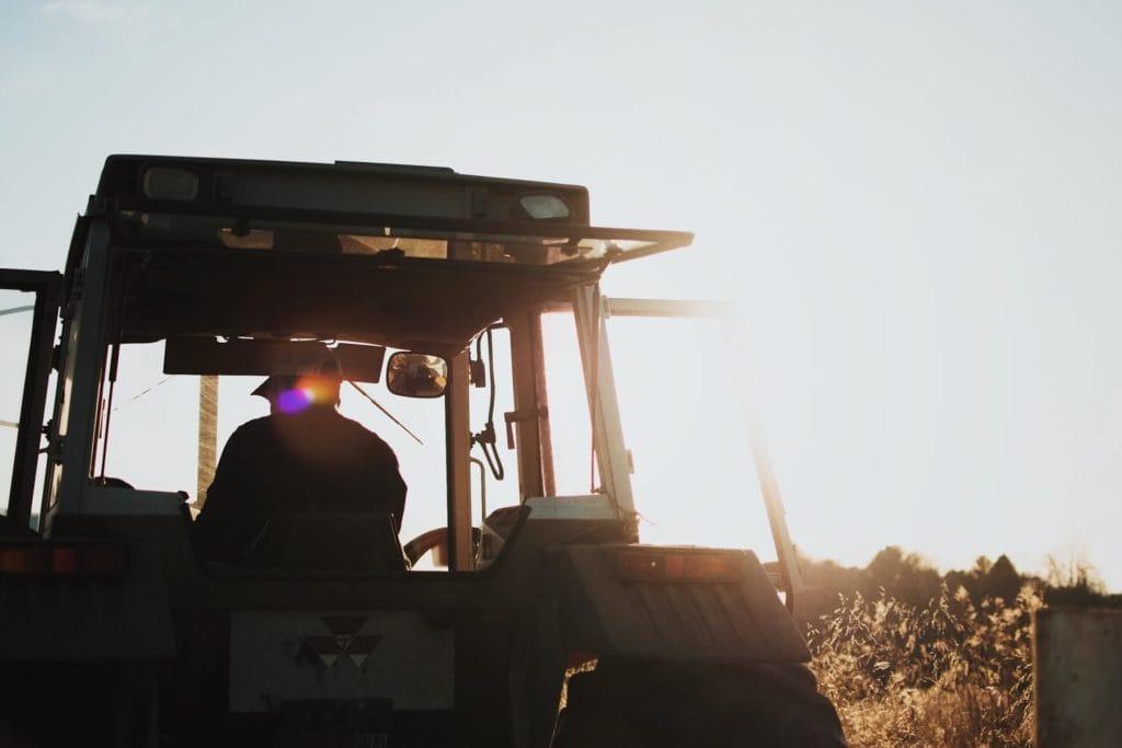 Man inside a tractor on a field