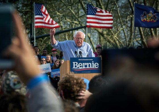 Bernie Sanders speaking in front of a crowd